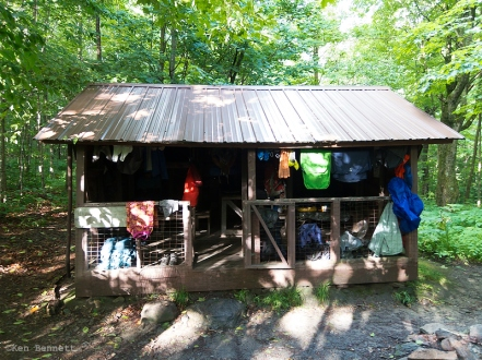 The David Logan Shelter, with five hikers and a ton of wet gear.
