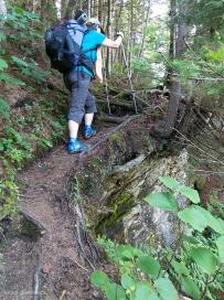DF climbs steep, narrow trail.
