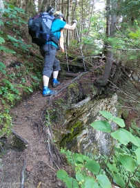 DF climbs steep, narrow trail.