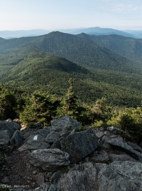 A view from the alpine area of Camel's Hump; note the white blaze on the rock.