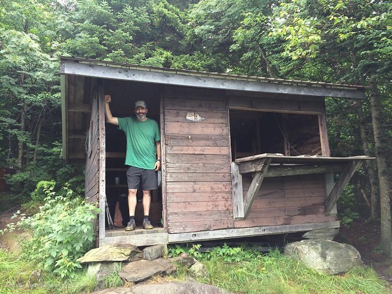 BC in the doorway at Tillotson Camp.