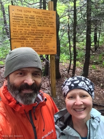 In front of the sign at the northern terminus. It was still kind of cold.